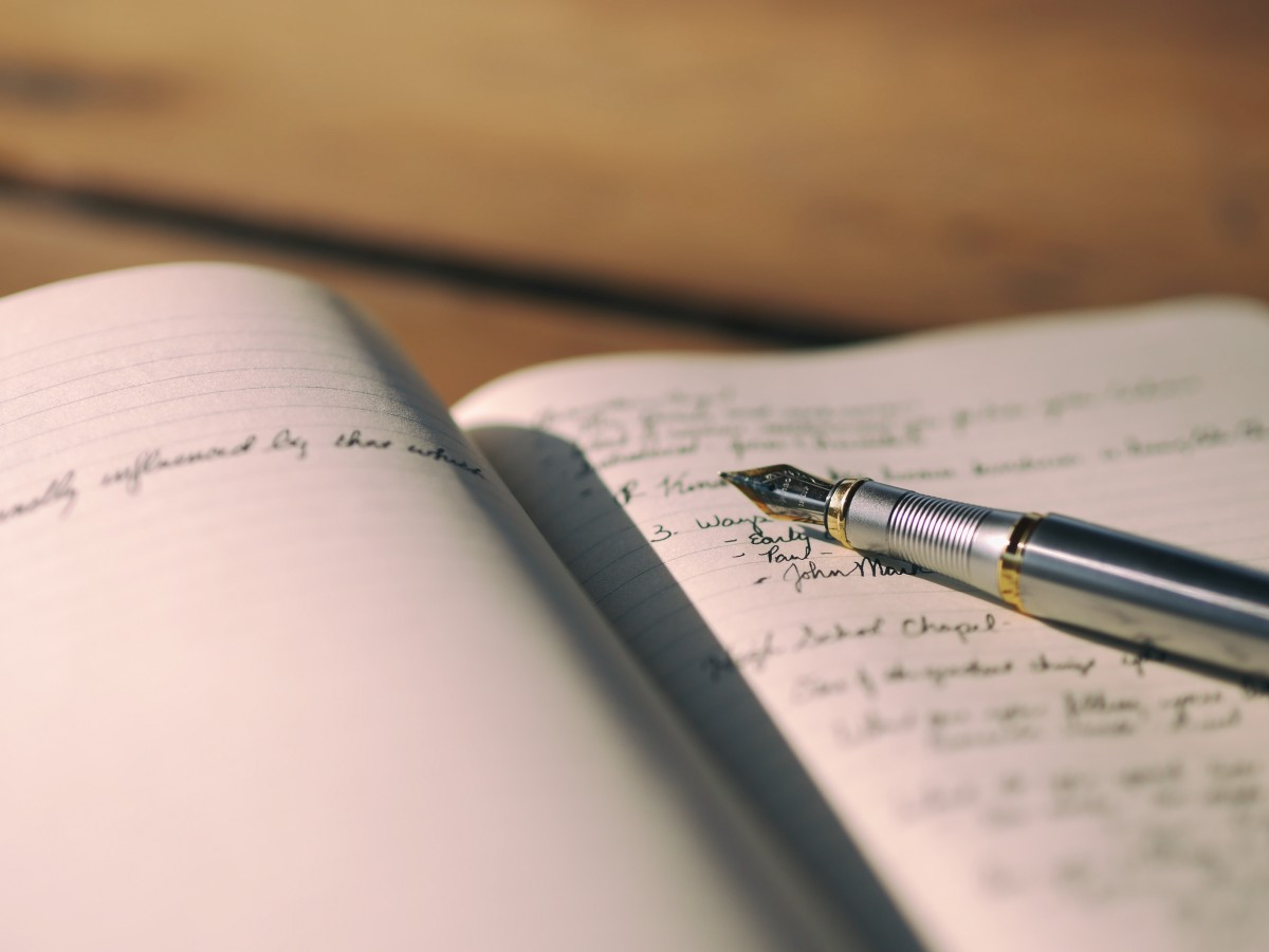 notebook and fountain pen writing book