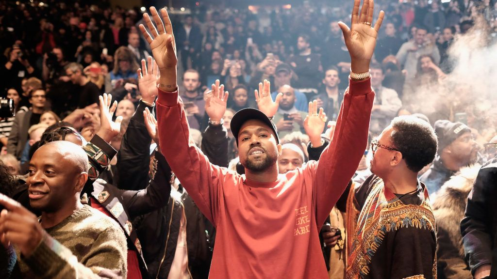 Kanye West wearing red