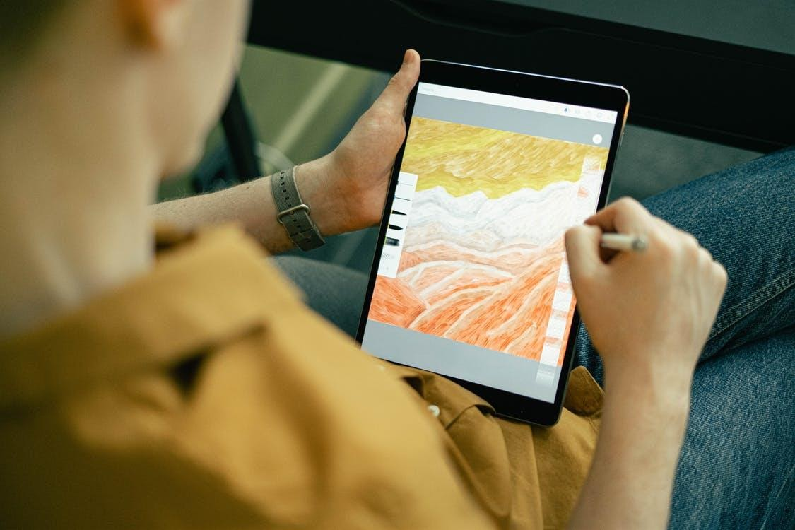 NFT Artwork creation with a man using a tablet