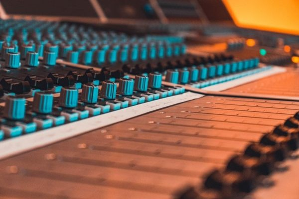 mixing desk with blue buttons